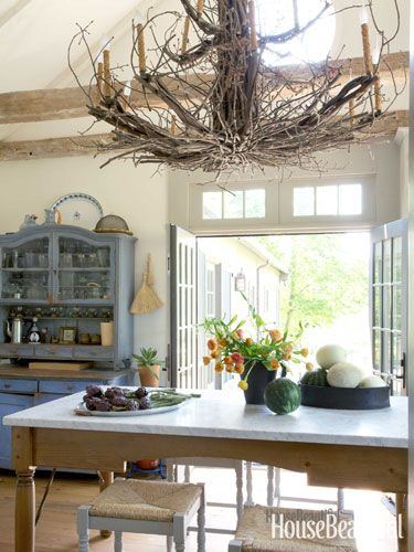 A showstopping twig chandelier brings a natural element, and some whimsy, inside.