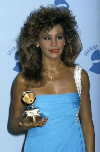 Whitney winning her first Grammy 1985