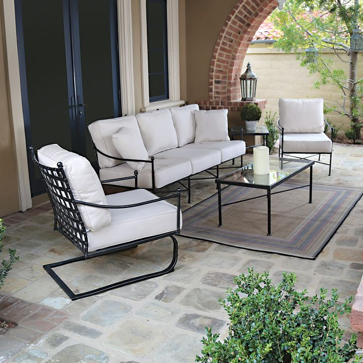 Patio Furniture Seattle Iron Chairs Cushioned Chair Gl Table Small Rug Candle And Plant In Vase Decoration Of Stylish For Outdoor