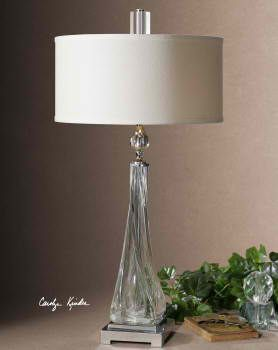 Gracona Twister Glass. Thick, twisted glass base with polished nickel details and crystal accents. The round, hardback drum shade is a off white linen fabric. #lamp #LightsandLamps #homedecor #accentfurniture #tablelamp #CarolynKinder