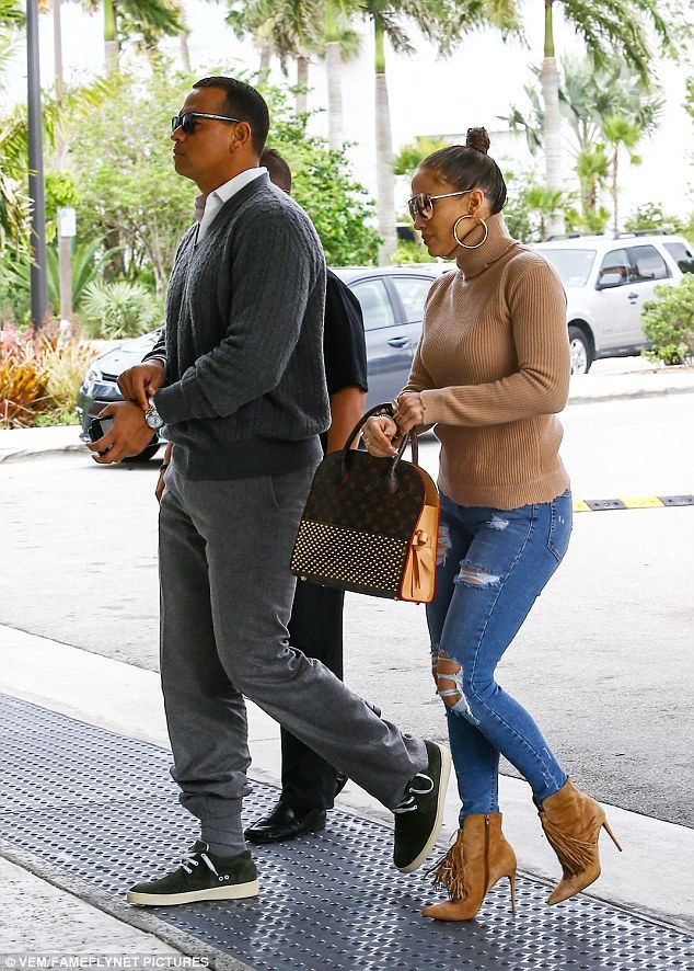 In transit: Jennifer Lopez and Alex Rodriguez, who've got close enough they've just spent Easter together, were spotted heading to the airport in Miami on Saturday