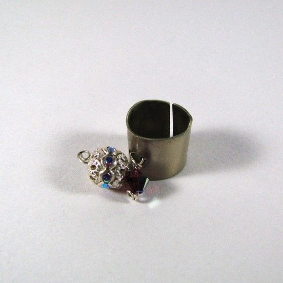 Handmade arzanto chevalier. On the ring there is a silver bead with iridescent zircons and swarovski stone.