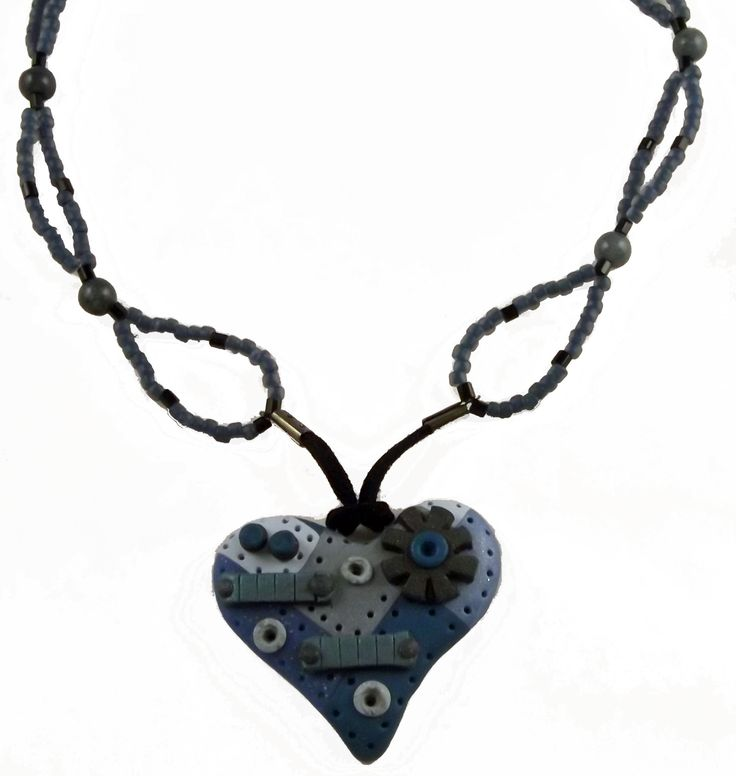 Blue and silver Steampunk heart pendant made from polymer clay.  I strung with matching blue seed beads.  Great to wear on casual Friday