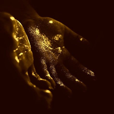 [ALCHEMY] Transformation. I think this image is probably meant to suggest gold flake on the hands, but I like the idea of these hands *becoming* gold in this way, beginning in the creases of the hands. It's a beautiful image.