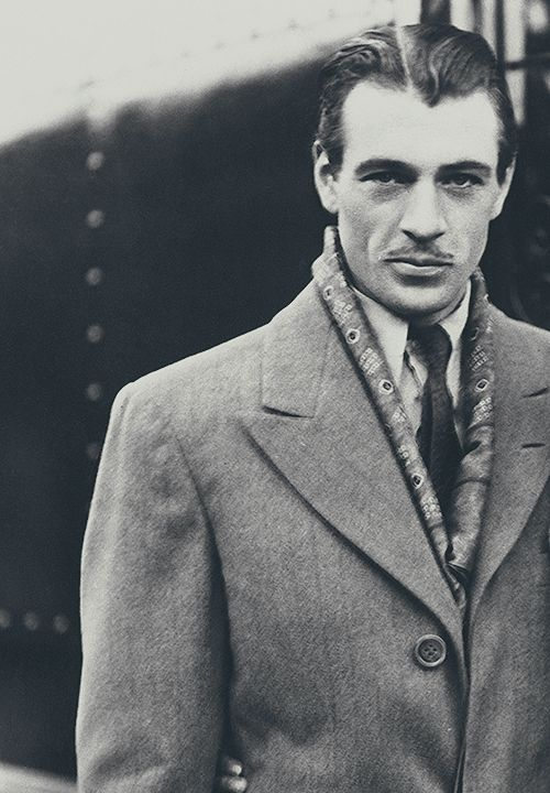 Gary Cooper...not sure about the mustache, but everything else...
