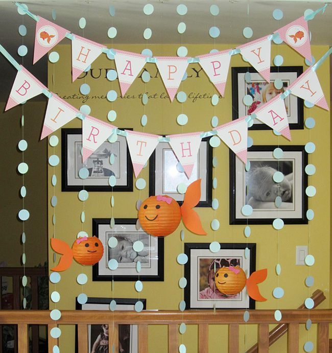 Girlie goldfish party - printable banner from Chickabug, and homemade goldfish lanterns!