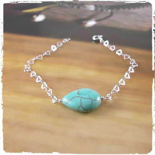 Cute 925 Silver heart bracelet with a Turquoise.