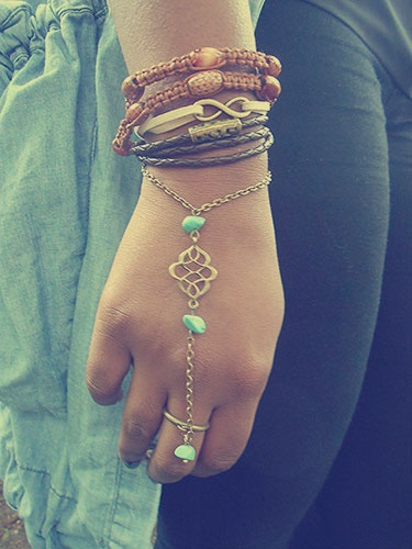 A collection of our bracelets, worn by the gorgeous Suzanne.