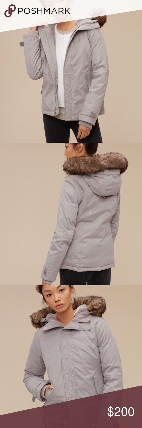 Aritzia goose down coat Brand new, never worn, with tags still on, pale grey goose down fitted parka coat, from Canadian brand Aritzia. Size medium (but would fit if you wear either a small or a medium normally)! This parka contains 100% responsibly sourced goose down and has a faux fur lining and detachable faux fur trim. It's a super warm, durable coat so there is no need to layer underneath, it's that cosy! It's also machine-washable which is so handy. Was $250 at full price! Aritzia…