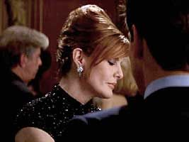Rene Russo with Classy Chic Half Updo in The Thomas Crown Affair - Beautiful Hairstyles