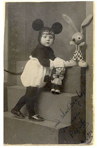 Vintage 1930ish picture of a child dressed up in a mickey mouse costume - check out the bunny soft toy on the top of the stairs - what a vintage yet modern looking character ;) Xx