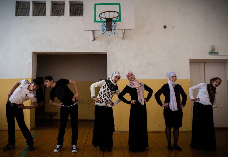 Gym class in Serzhen-Yurt. The schoolgirls, who are dressed in long, flowing skirts and head covers, refuse to wear their gym pants because they say it violates Muslim dress code.