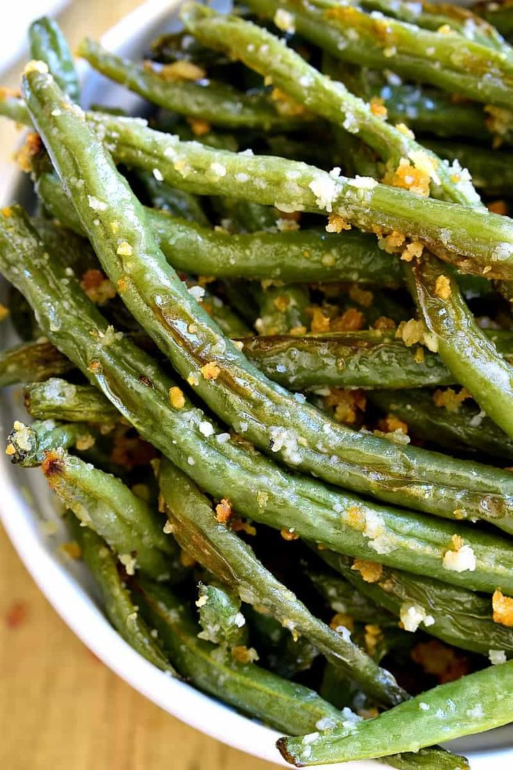 These Parmesan Roasted Green Beans are the most delicious way to enjoy fresh green beans! Perfect for holidays, dinners, or a healthy snack....and best of all, they're made with just 5 ingredients! So does it feel like spring where you live, too? We are having a MAJOR warm-up....and we couldn't be loving it more. We spent the weekend in sandals, with the windows wide open, and I'm pretty sure the girls played outside more than they have in the last 3 months combined. And I have to...