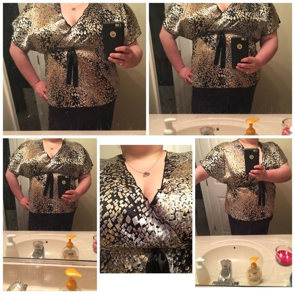 Black, white, yellow batwing top Black, white, yellow, grey batwing top. It is polyester and spandex but it feels like satin. It's gorgeous and I love the fit. Looks amazing with a cami underneath. Tops Blouses