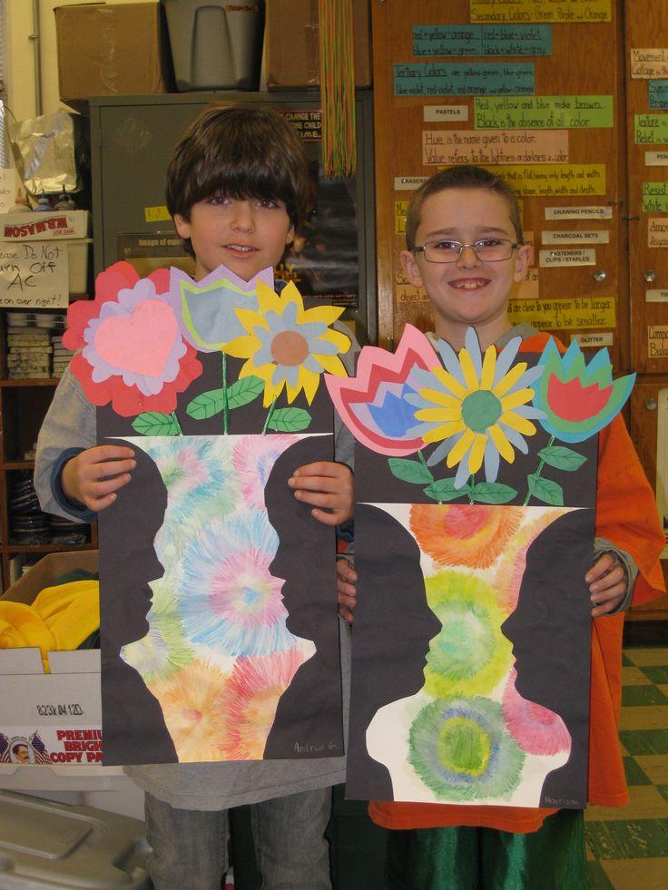 Profile Vase with 3D flowers- gr. 3, watercolor pencils, black paper profiles and construction paper flowers.