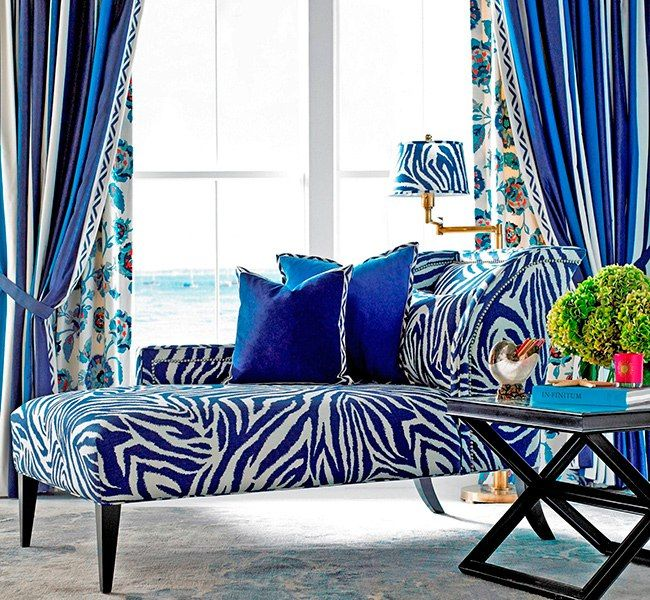A traditional Kravet chaise longue upholstered in Funky Zebra displays the chic, bohemian nature of the collection.