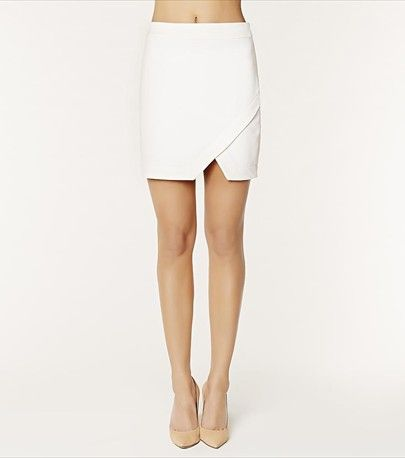 Skirt alert! This white mini crepe skirt is a must-have! It features a sexy side slit and a perfect cut that is sure to wow!