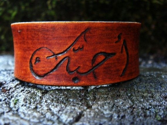 Hey, I found this really awesome Etsy listing at http://www.etsy.com/listing/60964469/i-love-you-in-arabic-engraved-in-leather