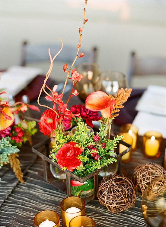 Eye-catching autumn centerpieces featuring berries, succulents, and wood slices like the ones we offer at Cheers.
