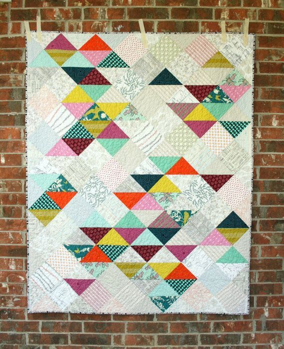 """Cute """"Archaeology"""" quilt (with pattern) by Emily McClendon of Quilts by Emily. I love the muted slightly texty background fabrics combined with the bright pops of color."""