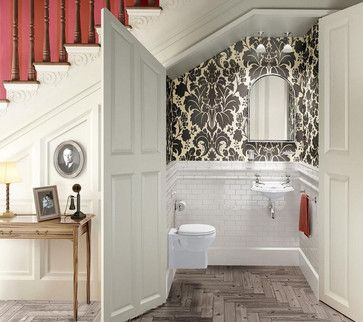 Don't love the wallpaper but love this under the staircase bathroom!