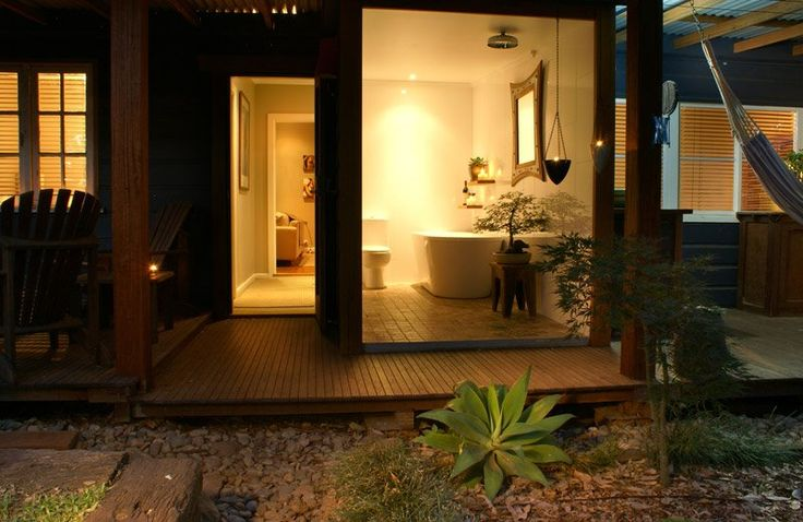"""Indoor/outdoor bathroom. There are glass doors and shower curtains for your privacy, but if you prefer,you can open it all up and enjoy a relaxing candle lit bath looking out to the """"Koi"""" pond and private garden."""