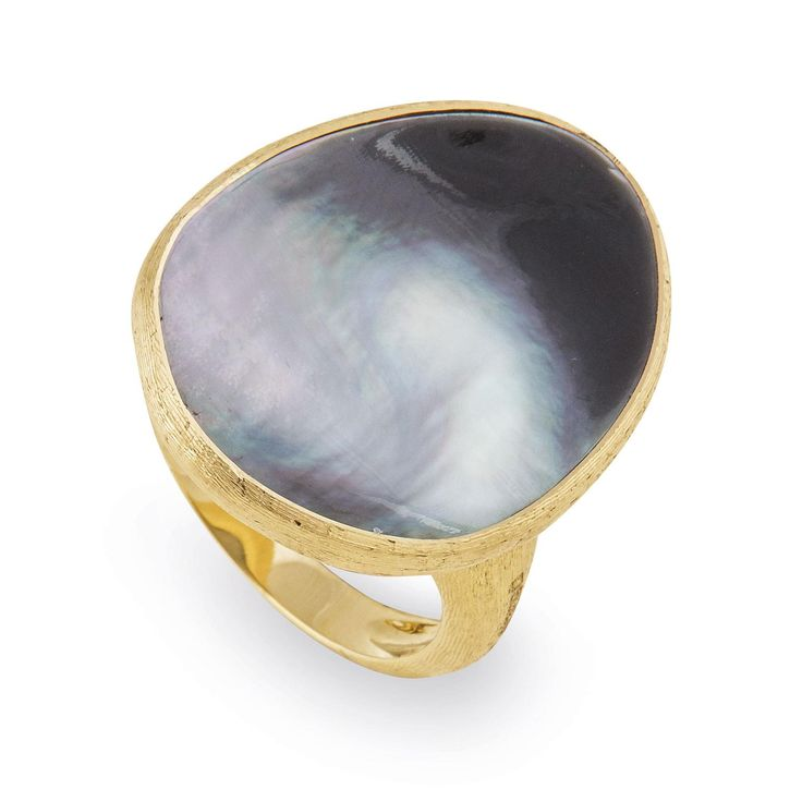 Marco Bicego Lunaria grey mother-of-pearl ring in yellow gold. Flat lay Tahitian style pearl iridescence. How jewellery designers are using mother of pearl in an up to date fashion forward way: http://www.thejewelleryeditor.com/jewellery/article/mother-of-pearl-jewellery-trend/ #jewelry