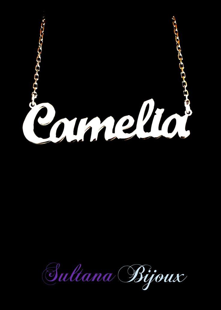 Colier din argint 925 personalizat cu numele Camelia. Realizam pe comanda cu numele/cuvantul ales de d-voastra. Lungime lant: 40 - 45 cm Lantisor reglabil Numele se scrie cu litere caligrafice (Scris de mana) *La orice colier care depaseste 7 caractere se taxeaza 5 lei / litera.