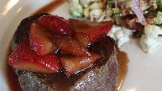Tender seared beef filets are quickly oven-roasted, then topped with sweet and savory marinated balsamic strawberries for a romantic presentation.