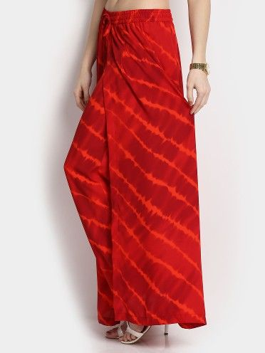 Match this pair of pants with a white solid top and slip into favorite pair of wedges. Add on a bandana and a pair of feather earrings to get a boho chic look.