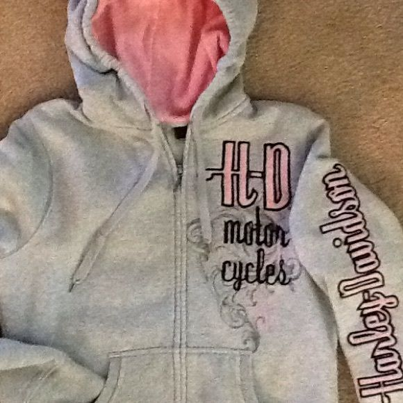 Harley Davidson zip front hoodie HD zip front hoodie with pink thermal lined hood. Embroidery detail front and back. Grey with pink and black detail. Size large, but fits more like a medium. Harley-Davidson Tops Sweatshirts & Hoodies