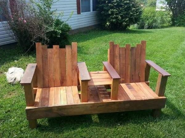 A Two-Seater With Integrated Table Out Of Repurposed Pallets Benches & Chairs