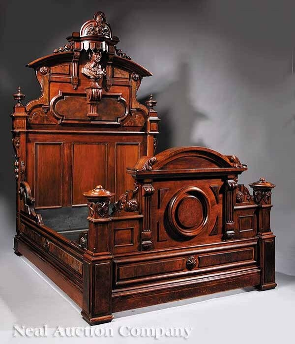 ornately carved wooden bed with large headboard and footboard.