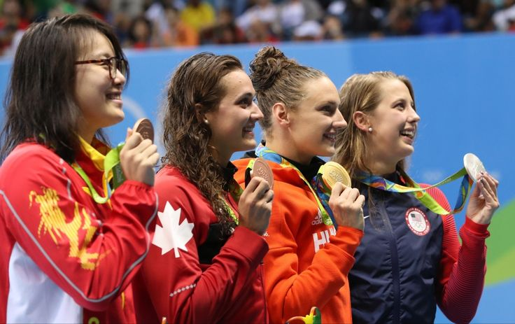 Winner Hungary's Katinka Hosszu, second right, second place United States' Kathleen Baker, right, and joint third place China's Fu Yuanhui, left, and Canada's Kylie Masse during the medal ceremony after the final of the the women's 100-meter backstroke at the swimming competitions at the 2016 Summer Olympics, Monday, Aug. 8, 2016, in Rio de Janeiro, Brazil. (AP / Lee Jin-man)