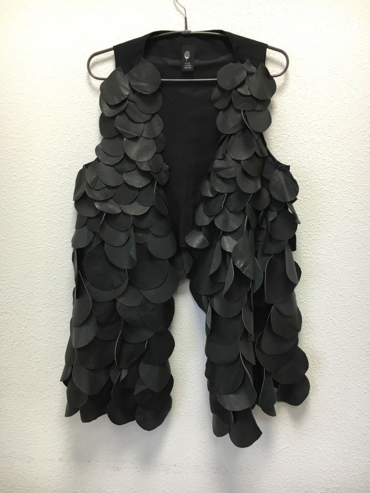 A personal favourite from my Etsy shop https://www.etsy.com/listing/286354127/leather-vest-recycled-leather-pieces