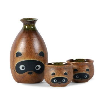 Tanuki Sake Set This ceramic Sake Set is modeled after the tanuki—or raccoon dog—known in Japanese folklore to be mischievous and jolly, but a bit absent-minded. What a fitting mood for drinking sake.