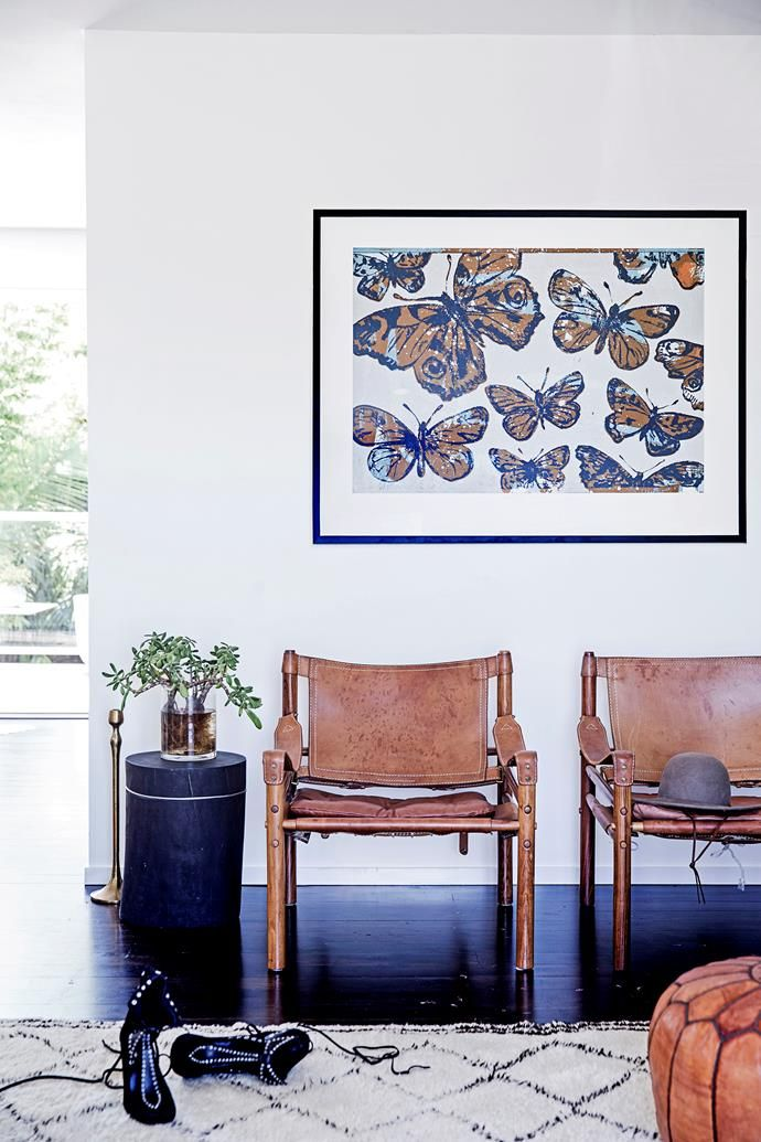 """Arne Norell safari chairs were found online. The butterfly artwork is by David Bromley, the rug from [Kulchi](http://www.kulchi.com/