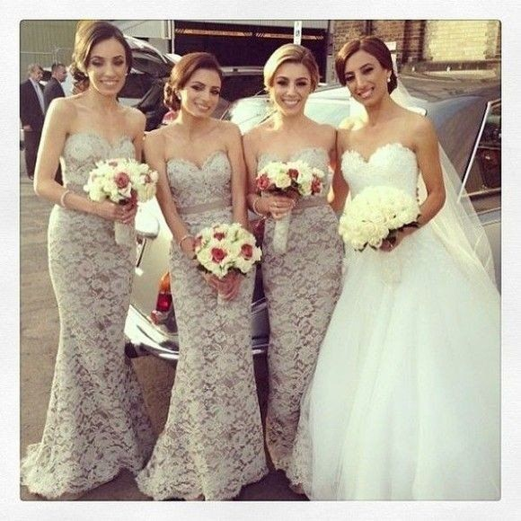These bridesmaids dresses, but with white flowers with a little green, and bride with red flowers