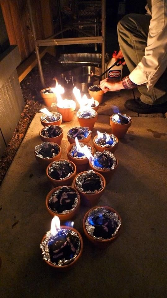 Line terracotta pots with aluminum foil, put some charcoals in there & light them for s'more making or other lighting ideas for back yard.