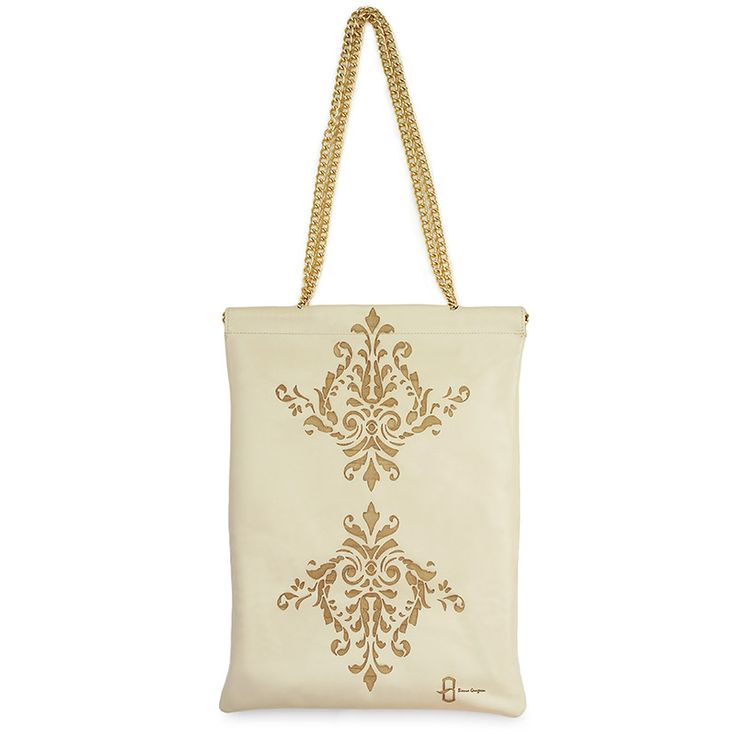 Large shoulder bag inspired by Islamic art. Made from natural leather and…