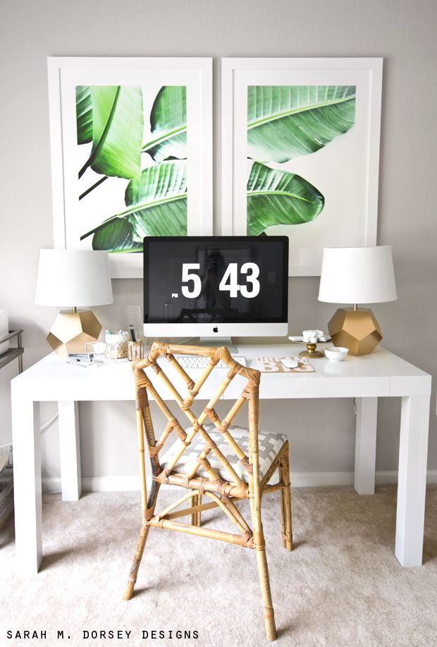 Spreading a large single image across two frames can create a striking display- here, this banana leaf design looks gorgeously graphic above this desk space.