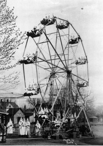 Carnival Day for the Klu Klux Klan. Photo taken on April 26, 1928. The carnival owner was also a klansman.   Sad and disturbing!  I don't blame them for wanting to hide their face - shame on them.