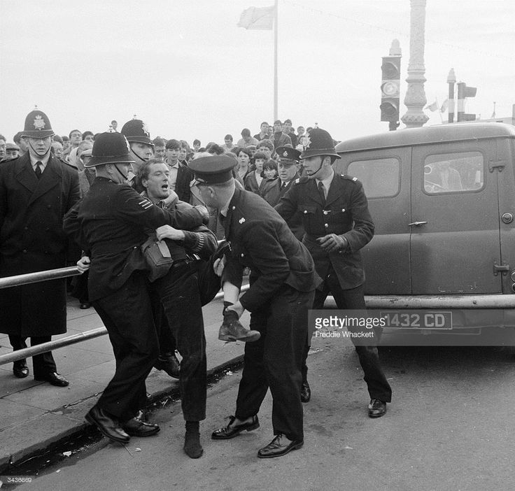 Police arresting people during clashes between mods and rockers at Brighton.