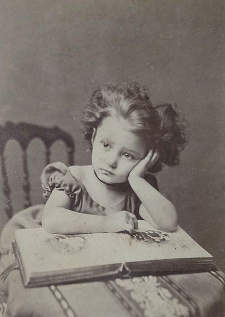 Little girl with photo album, 1870s. #Victorian #children #portraits