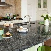 Traditional kitchen with granite-topped island unit