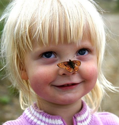 What fun, a butterfly on my nose!