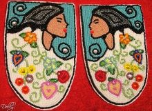 Walking With Our Sisters: moccasin vamps made by Dolly Assinewe for the murdered, missing First Nations women in Canada.