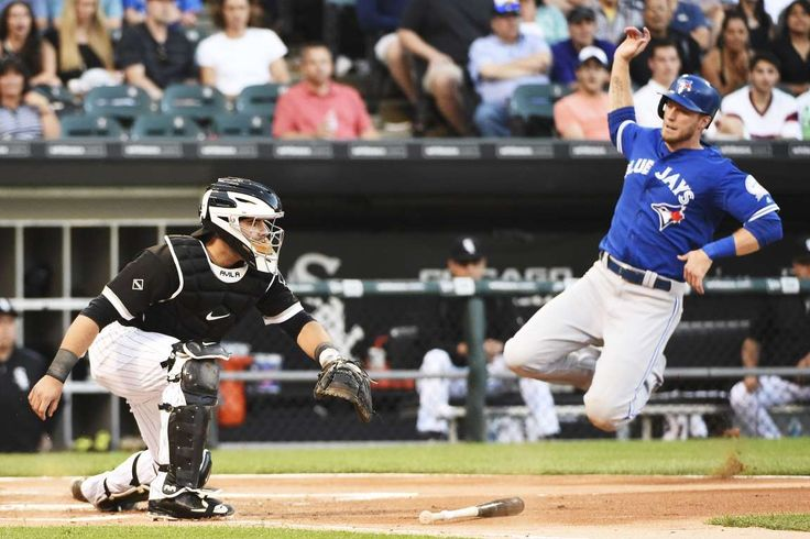 Diving to score: Michael Saunders of the Toronto Blue Jays, right, scores as Alex Avila of the Chicago White Sox waits for the throw during the second inning at U.S. Cellular Field in Chicago on June 24.