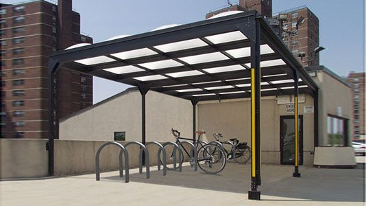 Covered Bike Shelter Width : Annex is a slim profile wall mounted bike shelter that