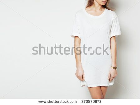 Young woman wearing blank long vest and digital watch. White background
